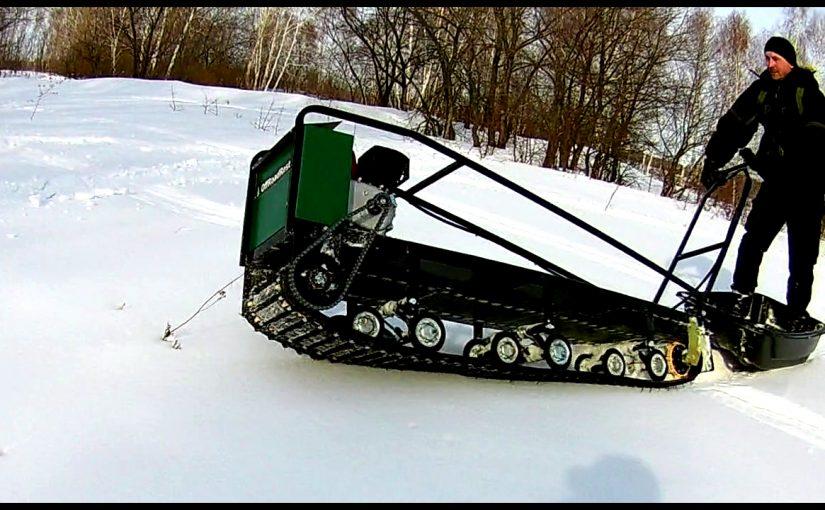 Мотобуксировщик повышенной проходимости на длинной Бурановской гусенице